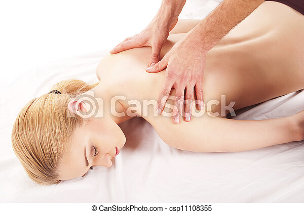 pretty woman getting shoulder and back massage - csp11108355