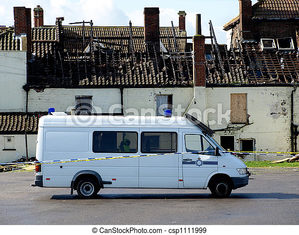 Crime Scene Fire Damaged House with police van outside - csp1111999