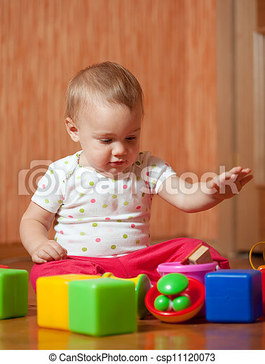tranquil baby  plays with toys  - csp11120073