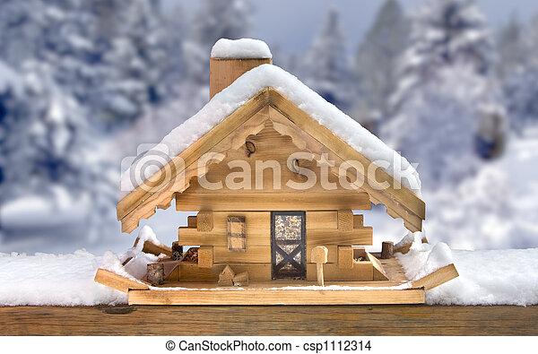 Photo de bois oiseau maison nourrisseur dans neige csp1112314 recherchez des images des - Maison oiseau bois ...