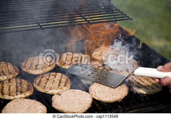 Person Flipping Burgers During BBQ - csp1113549