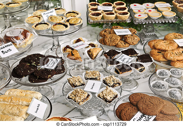 Desserts in bakery window - csp1113729