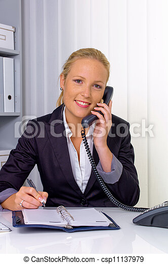 woman with phone in office - csp11137979