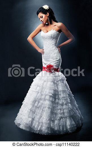 Luxurious bride brunette fashion model in bridal white dress - csp11140222