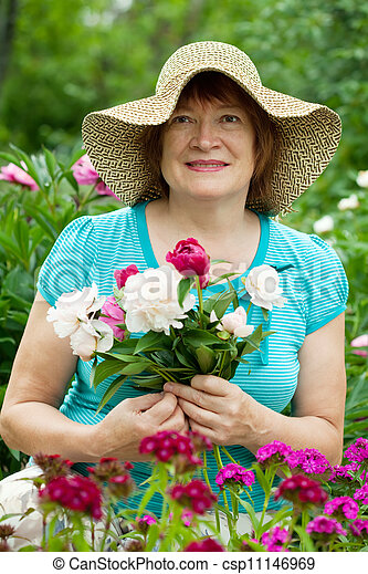 Happy mature woman with flowers   - csp11146969