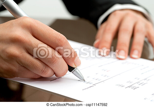 Female hand with pen pointing on accounting document. - csp11147592