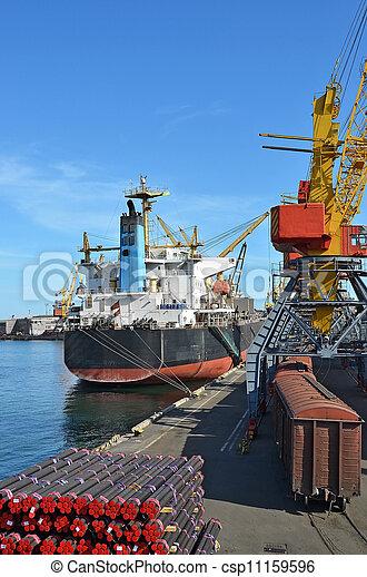 Pipe stack, ship ans train under crane bridge - csp11159596