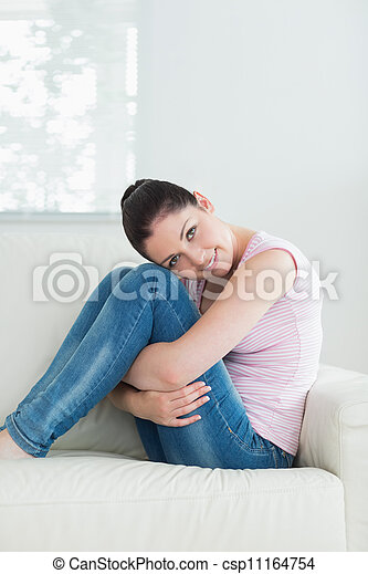 Relaxing woman sitting in a living room