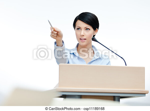 Female lecturer at the podium. Business conference - csp11189168