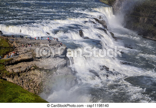 Gullfoss wild waterfall, strong running water and people, Iceland - csp11198140