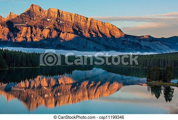 Orange Mountain Reflection in Lake Minnewanka - csp11199346