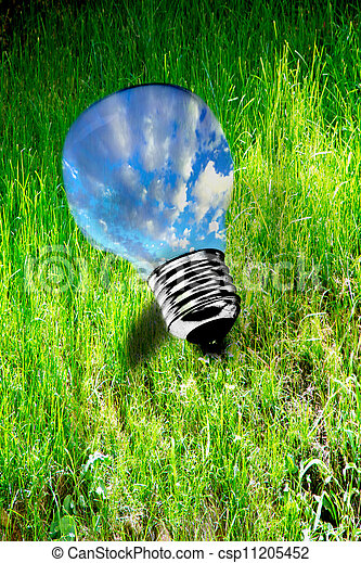 sky inside lightbulb on grass, clean energy - csp11205452