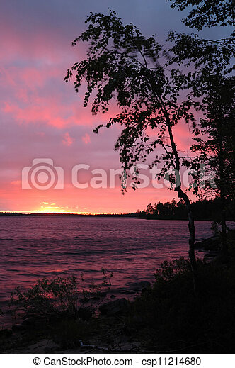Beautiful sunset on Karelia Engozero lake, Nothern Russia - csp11214680