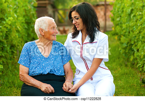 Chatting with an elderly woman - csp11222828