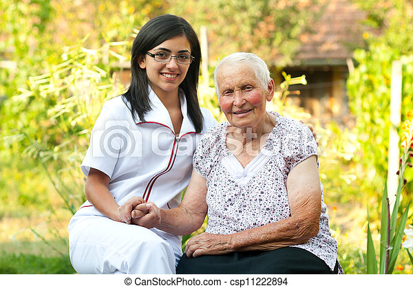 Caring doctor with elderly woman - csp11222894
