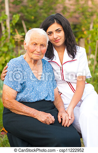 Caring doctor with elderly lady - csp11222952