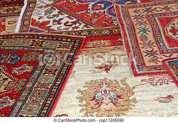 collection of antique oriental carpets expensive on display in the antiques boutique - csp11245590