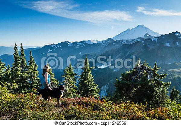 Beautiful Women Walking Dog in Mountains. - csp11246556