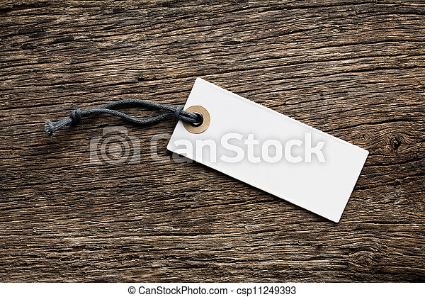 blank price tag label on wooden background - csp11249393