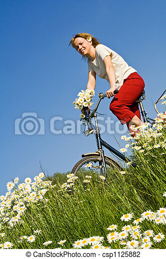 Woman with bicycle among spring flowers - csp1125882