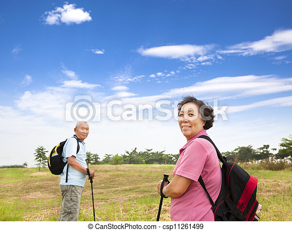 happy asian senior couple hiking in the nature - csp11261499