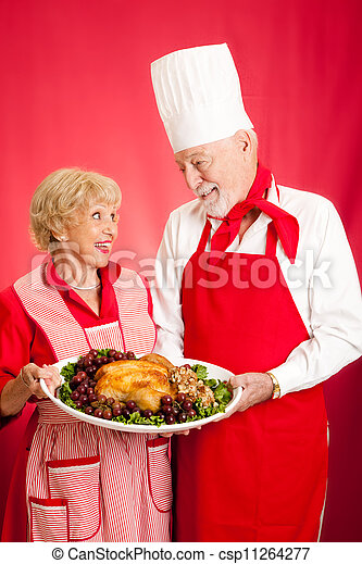 Chef and Homemaker with Holiday Dinner - csp11264277