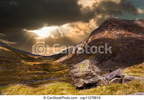Moody dramatic mountain sunset landscape - csp11278819