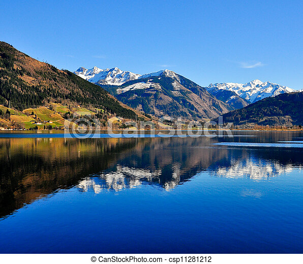 Blue mountain lake landscape view with mountain reflection - csp11281212
