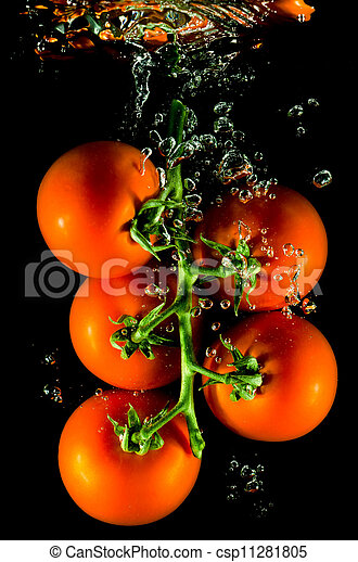 tomatoes falling into water - csp11281805