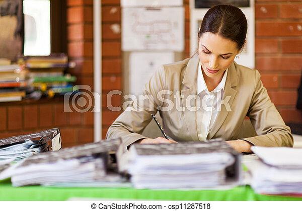 school teacher working in office - csp11287518