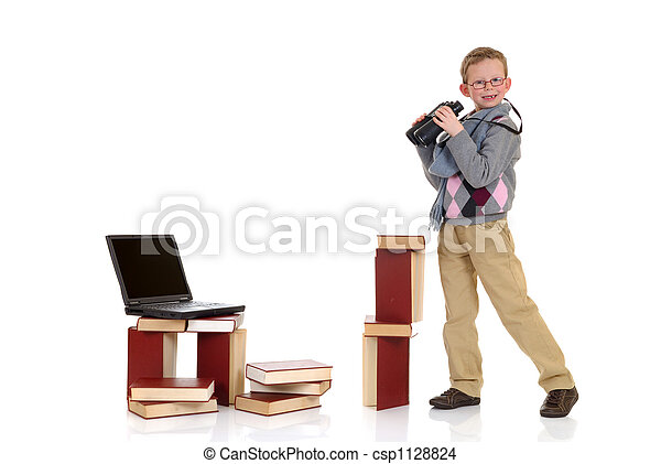 Eight year young boy studying - csp1128824