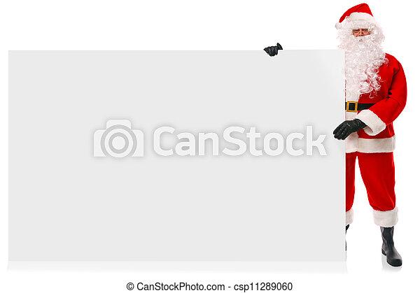 Full length Santa holding large blank sign - csp11289060