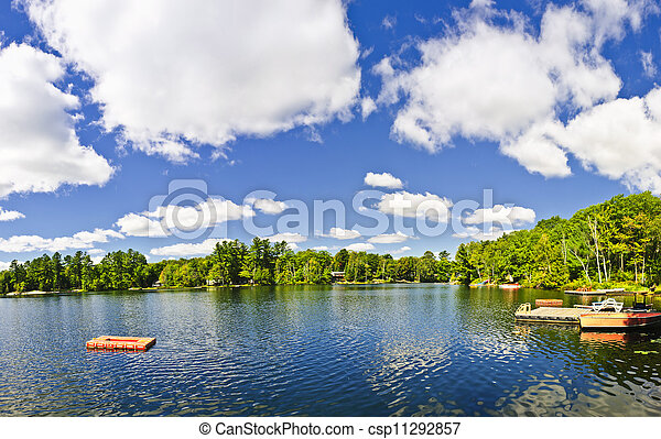 Cottage lake with diving platform and dock - csp11292857