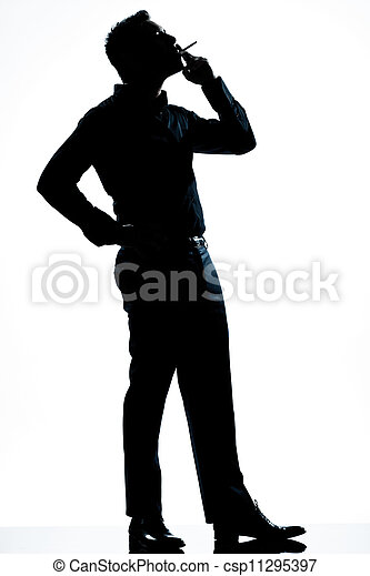 silhouette man full length smoking cigarette - csp11295397