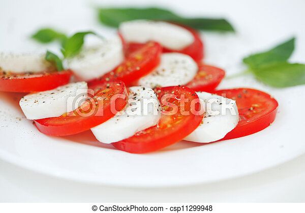 Caprese - Italian salad with cherry tomatos and mozarella cheese