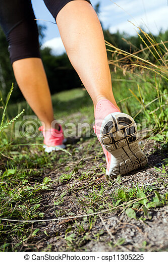 Walking or running legs in forest, summer nature activity - csp11305225