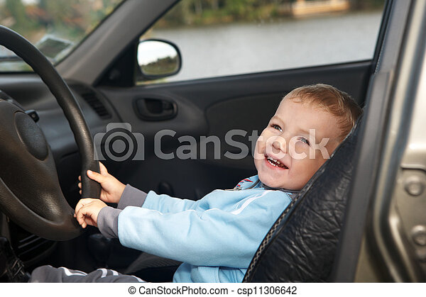 The boy sits in the automobile - csp11306642