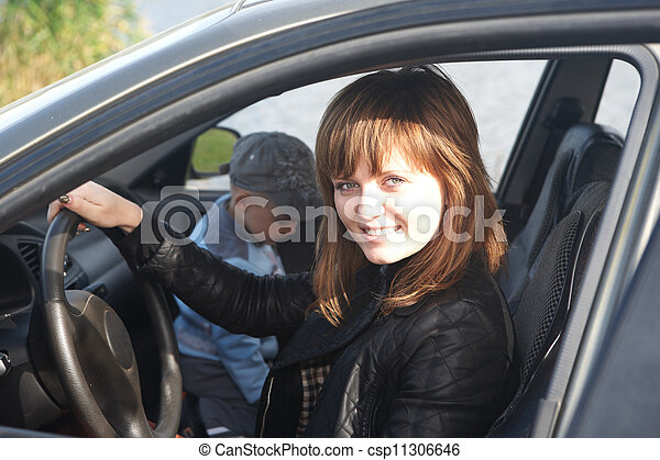 The girl sits in the automobile - csp11306646