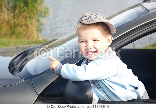 The boy looks out from the automobile - csp11306649