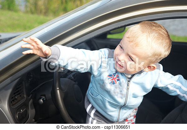 The boy looks out from the automobile - csp11306651