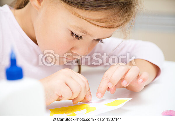 Little girl doing arts and crafts in preschool - csp11307141