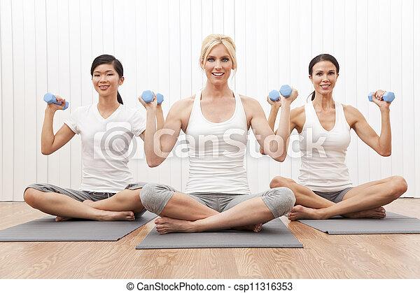 Interracial Yoga Group of Three Women Weight Training  - csp11316353