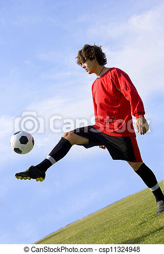 Soccer - Football Player Juggling in Red - csp11324948