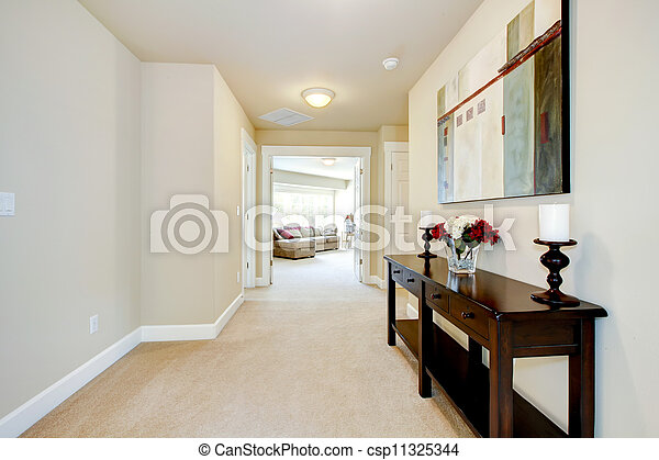 Large home hallway with art and furniture. - csp11325344