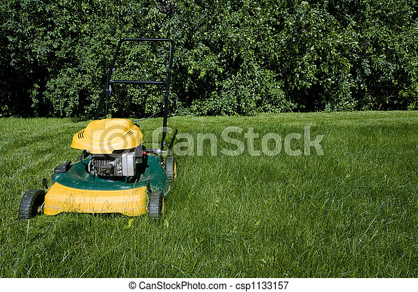 Lawnmower, cutting green grass close-up with space for copy - csp1133157