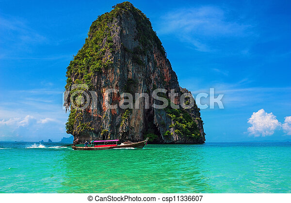 Travel landscape, beach with blue water and sky at summer. Thailand nature beautiful island and traditional wooden boat. Scenery tropical paradise resort. - csp11336607