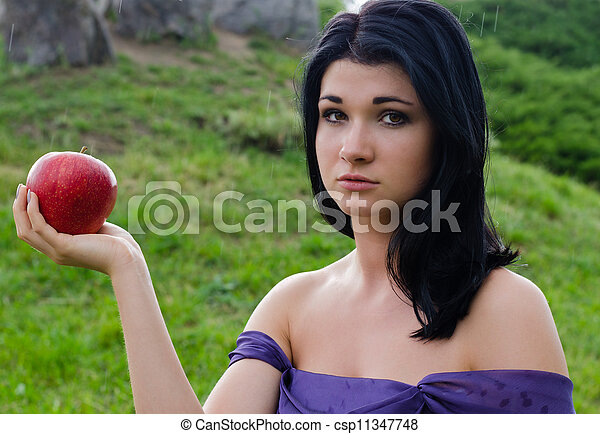 Stock Photo of Disconsolate woman with an apple ...