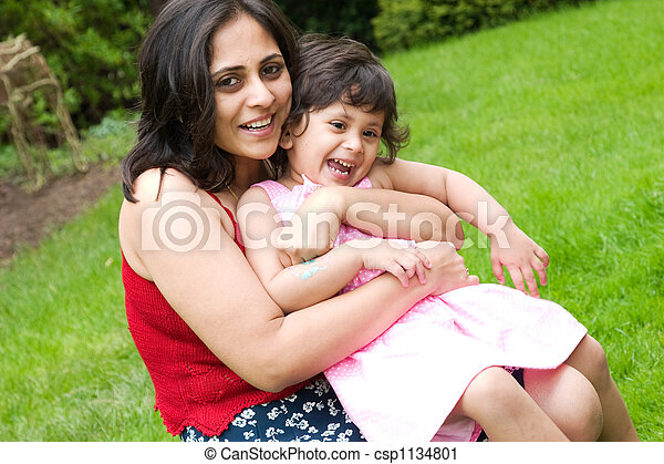 Mother and daughter playing outside - csp1134801