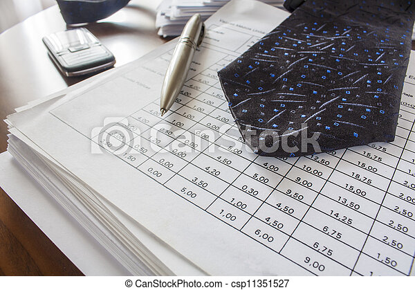 bills ,pen,cell phone  and necktie,accounting - csp11351527
