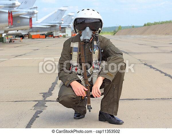 military pilot in a helmet near the aircraft - csp11353502